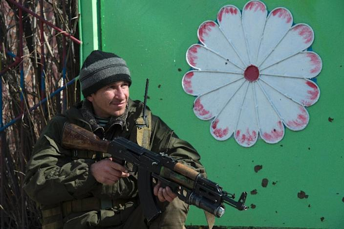 A soldier of the self-proclaimed Donetsk People's Republic (DNR) stands guard on a street in the frontline town of Shyrokyne, some 10 kms east of Mariupol, on March 20, 2015 (AFP Photo/John MacDougall)