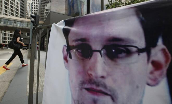 A banner supporting Edward Snowden is displayed in Hong Kong's business district, June 20.