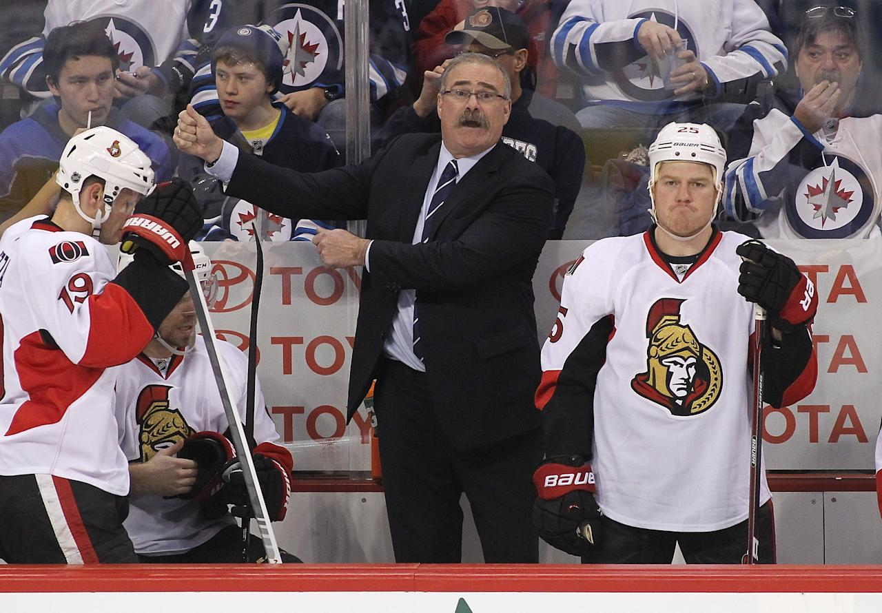 WINNIPEG, MB - JANUARY 19:  Paul MacLean, head coach of the Ottawa Senators gestures from the bench during second period action in a game against the Winnipeg Jets on January 19, 2013 at the MTS Centre in Winnipeg, Manitoba, Canada. (Photo by Marianne Helm/Getty Images)