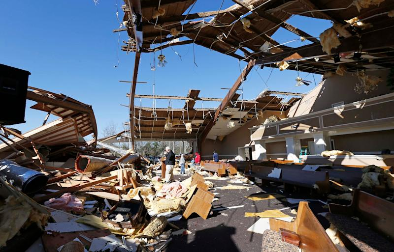 Stunned residents of Columbus, Mississippi, were picking up the pieces Sunday after a violent tornado ripped through town, leaving one person dead.