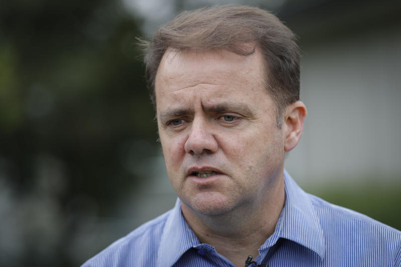 Cashmere High School principal Mark Wilson speaks to The Associated Press during an interview at the school in Christchurch, New Zealand, Sunday, March 17, 2019. Three students from Cashmere High School were at a mosque for Friday prayers when an attacker burst in as part of a rampage that left dozens of dead across the New Zealand city of Christchurch. When classes resume Monday, none will be there. Two of the students are presumed dead and the third is in the hospital with gunshot wounds.(AP Photo/Vincent Thian)