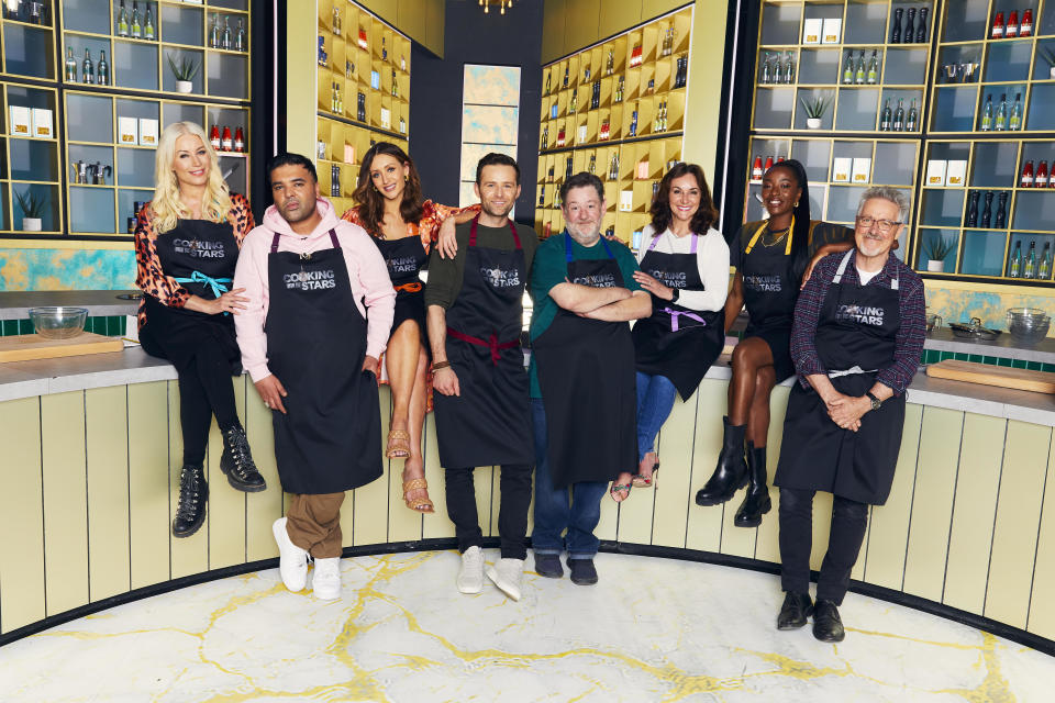 Cooking With The Stars contestants Denise van Outen, Naughty Boy, Catherine Tyldesley, Harry Judd, Johnny Vegas, Shirley Ballas, AJ Odudu and Griff Rhys Jones. (ITV)