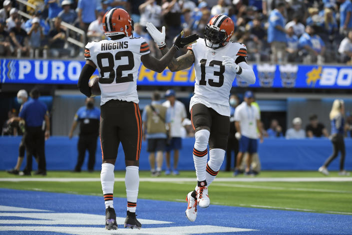 Cleveland Browns wide receiver Rashard Higgins (82) celebrates his touchdown catch with wide receiver Odell Beckham Jr. (13) during the first half of an NFL football game against the Los Angeles Chargers Sunday, Oct. 10, 2021, in Inglewood, Calif. (AP Photo/Kevork Djansezian)