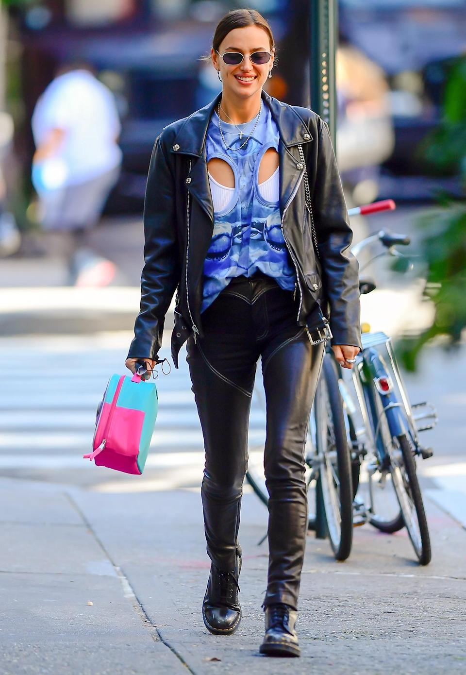 <p>Irina Shayk wears a blue cutout top while out on Wednesday in N.Y.C.'s Soho area. </p>