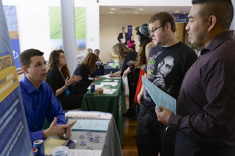 In this April 10, 2014 photo, John Soung, right, and Gabriel Fitzgerald, second right, talk to recruiter Todd Zedicher of Integrated Life Choices, left, at a job fair on the campus of Kaplan University in Lincoln, Neb. The Labor Department on Friday, May 2, 2014 said U.S. employers added a robust 288,000 jobs in April, the most in two years, the strongest evidence to date that the economy is picking up after a brutal winter slowed growth. (AP Photo/Nati Harnik)