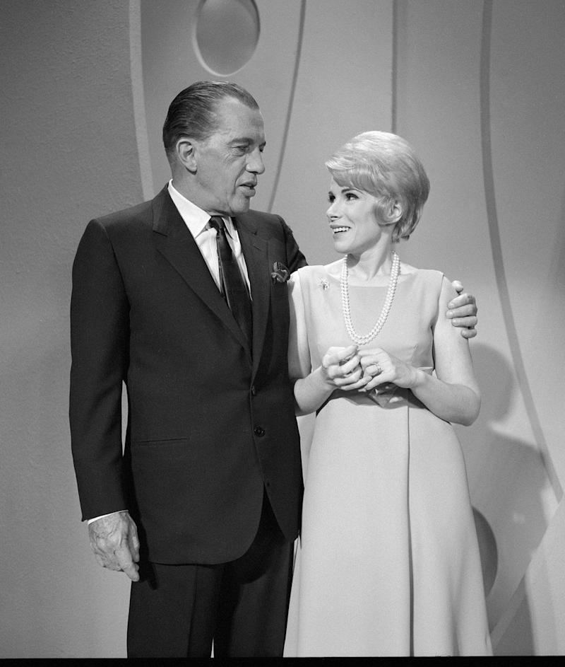 "American talk show host Ed Sullivan puts his arm around Joan Rivers as they chat on ""The Ed Sullivan Show,"" New York, New York, September 11, 1966. (CBS Photo Archive/Getty Images)"