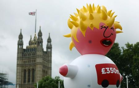 A giant inflatable blimp depicting Boris Johnson is seen near The Houses of Parliament ahead of anti-Brexit 'No to Boris, Yes to Europe' protest in London