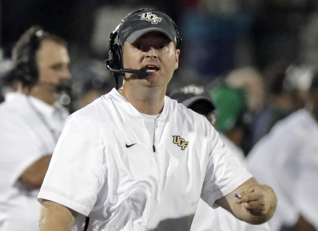 FILE - In this Sept. 21, 2018, file photo, Central Florida head coach Josh Heupel directs his team against Florida Atlantic during the second half of an NCAA college football game n Orlando, Fla. No. 11 UCF, heavily favored to beat Navy to remain unbeaten and extend the nation's longest winning streak to 22 games, insists the Knights arent paying attention to chatter about their chances of winding up in the College Football Playoff. We talk about it every day. ... Outside noise has no impact on what we are, Heupel reiterated. (AP Photo/John Raoux, File)
