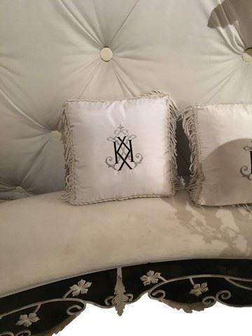 Custom pillows feature Kim's favorite letter. (Photo: Premiere Props)