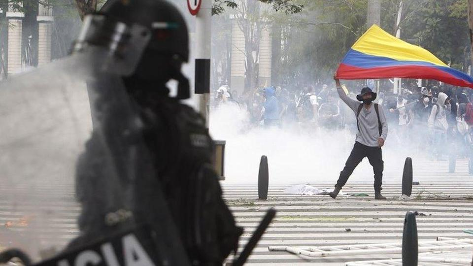 Demonstrators clashes with police in the protests against the tax reform called by the labour unions, in Medellin, Colombia, 28 April 2021.
