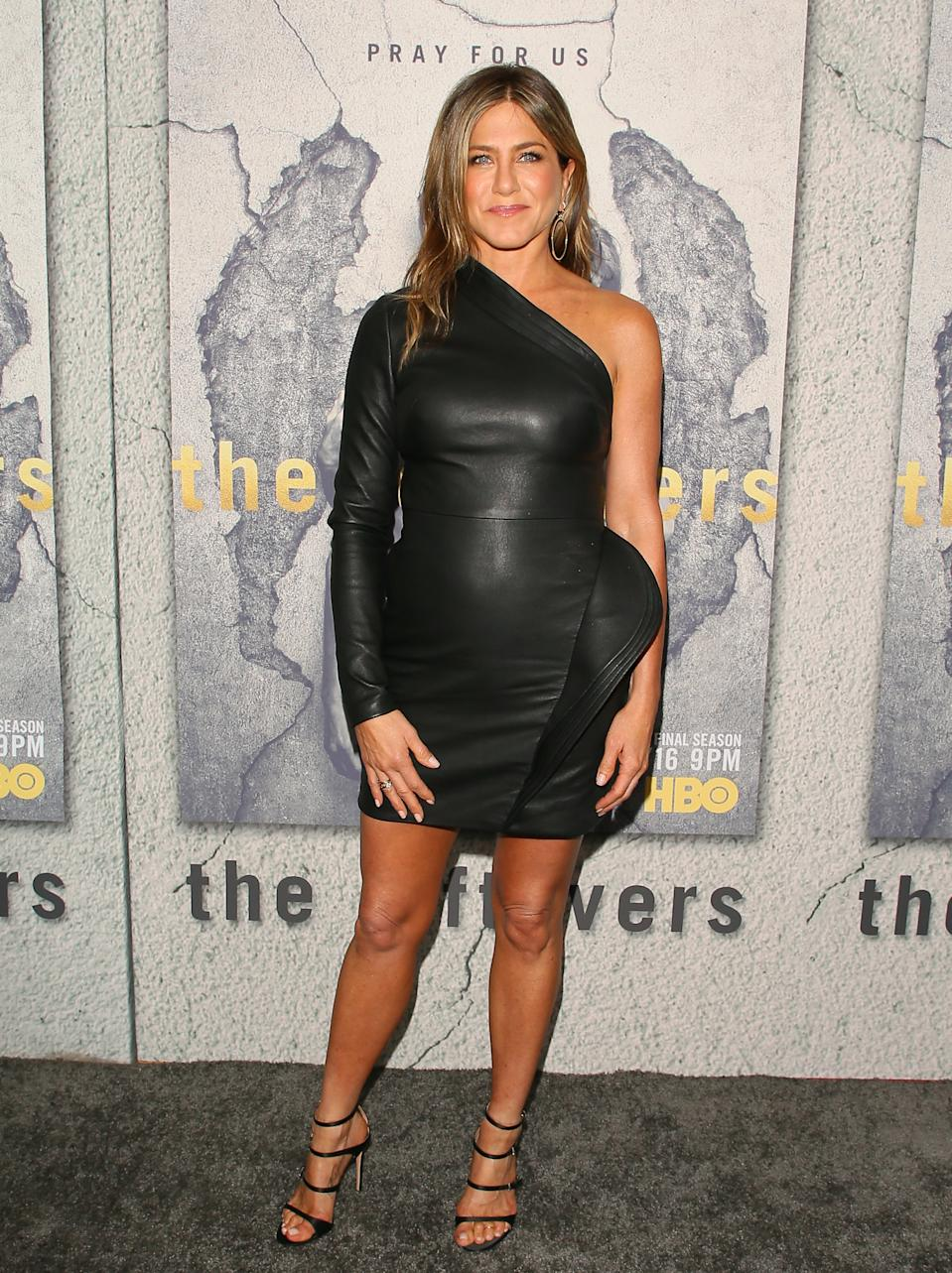 "Aniston's asymmetrical leather dress by Brandon Maxwell was an out-of-the-box fashion moment at ""The Leftovers"" premiere in 2017. (Photo by JB Lacroix/WireImage)"