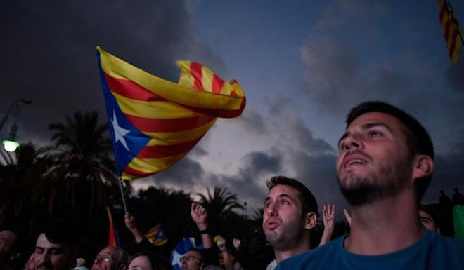 Supporters of Catalan independence listen to a speech in 2017. Photo: AFP