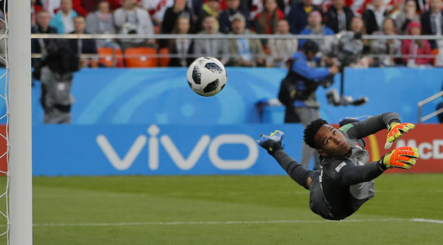 Peru goalkeeper Pedro Gallese dives for a save during the group C match between France and Peru at the 2018 soccer World Cup in the Yekaterinburg Arena in Yekaterinburg, Russia, Thursday, June 21, 2018. (AP Photo/Vadim Ghirda)
