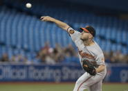 Baltimore Orioles starting pitcher Dylan Bundy throws to a Toronto Blue Jays batter during the first inning of a baseball game Tuesday, Sept. 24, 2019, in Toronto. (Fred Thornhill/The Canadian Press via AP)