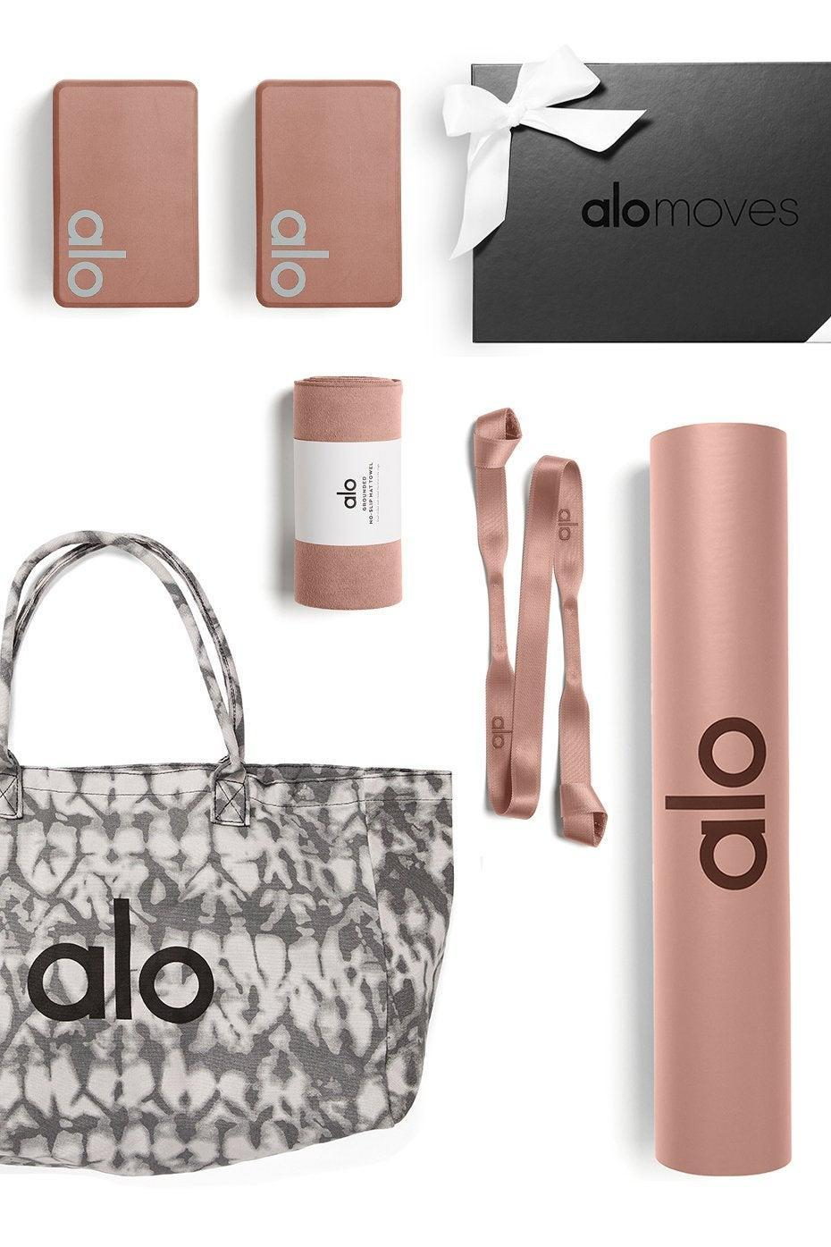 "<h2>Alo Yoga Ultimate Home Studio Set</h2>If they've been using the same, worn out yoga gear for years, it may be time to gift them an entire matching set. This bundle includes blocks, a bag, a yoga strap, a mat, a towel, and an entire year's subscription of <a href=""https://www.refinery29.com/en-us/2020/12/10206788/fitness-gift-cards-2020"" rel=""nofollow noopener"" target=""_blank"" data-ylk=""slk:Alo Moves"" class=""link rapid-noclick-resp"">Alo Moves</a>.<br><br><br><strong>Alo Yoga</strong> Ultimate Home Studio Set, $, available at <a href=""https://go.skimresources.com/?id=30283X879131&url=https%3A%2F%2Fwww.aloyoga.com%2Fproducts%2Fultimate-home-studio-set"" rel=""nofollow noopener"" target=""_blank"" data-ylk=""slk:Alo Yoga"" class=""link rapid-noclick-resp"">Alo Yoga</a>"