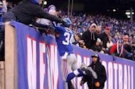 Dec 20, 2015; East Rutherford, NJ, USA; New York Giants running back Shane Vereen (34) jumps into the stands after scoring a touchdown against the Carolina Panthers during the fourth quarter at MetLife Stadium. Mandatory Credit: Brad Penner-USA TODAY Sports