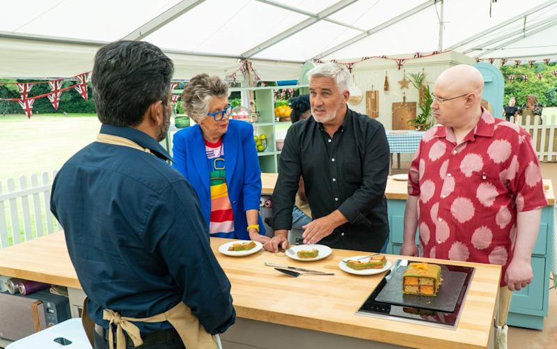 """Prue Leith Paul Hollywood and Matt Lucas talk to a contestant on """"The Great British Baking Show."""""""