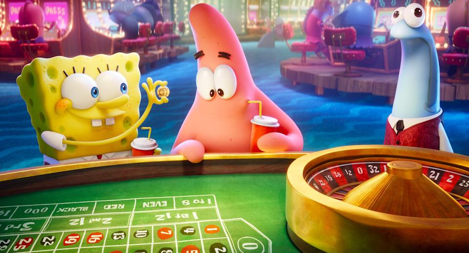 "SpongeBob (voiced by Tom Kenny, left) and Patrick (Bill Fagerbakke) hit the roulette table in the Lost City of Atlantic City in ""The SpongeBob Movie: Sponge on the Run."""