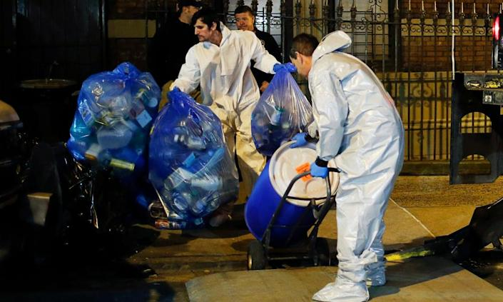 Members of a cleaning crew push a barrel to be loaded in a CDC truck after cleaning the New York apartment of a doctor exposed to Ebola in October 2014. The CDC has been at the forefront the US response to pandemics.