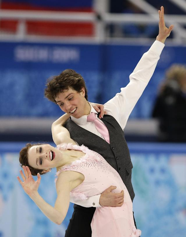 Alexandra Paul and Mitchell Islam of Canada compete in the ice dance short dance figure skating competition at the Iceberg Skating Palace during the 2014 Winter Olympics, Sunday, Feb. 16, 2014, in Sochi, Russia. (AP Photo/Darron Cummings)