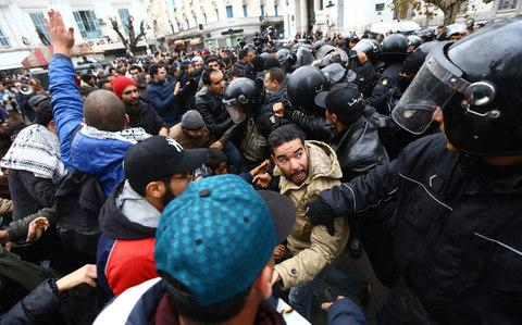 Police intervene during a protest in Tunis on January 12, 2018 - Credit: Anadolu
