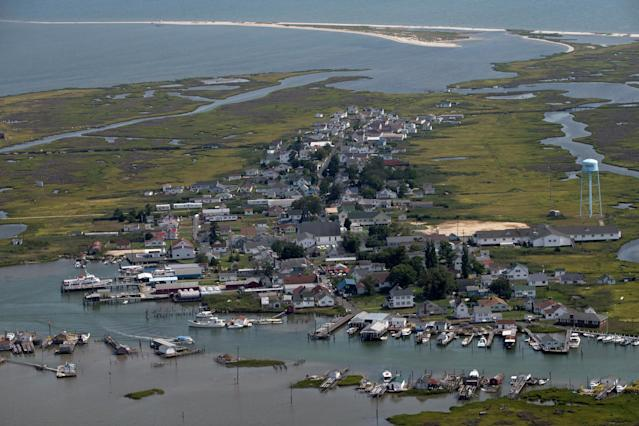 <p>Homes and businesses line Main Ridge Road in this aerial view over Tangier Island, Virginia, Aug. 2, 2017. (Photo: Adrees Latif/Reuters) </p>