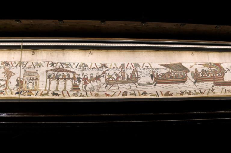 A portion of the historic Bayeux Tapestry which Theresa May said would be returning to Britain in 2022 for the first time in 900 years