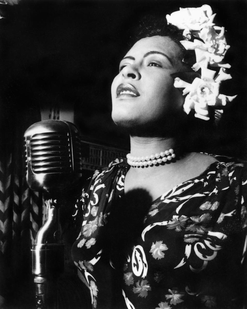 """<p>One of the most iconic singers of all time, Billie Holiday was known for <a href=""""http://www.theatlantic.com/magazine/archive/2000/11/our-lady-of-sorrows/378438/"""" rel=""""nofollow noopener"""" target=""""_blank"""" data-ylk=""""slk:singing songs of sorrow"""" class=""""link rapid-noclick-resp"""">singing songs of sorrow</a> in her raspy voice. Holiday was highly influential, with signature songs — such as """"Stormy Blues"""" and """"Lady Sings the Blues"""" that were later covered by Ella Fitzgerald and Diana Ross. When performing, especially in the 1930s, Holiday usually wore beautifully patterned dresses, pearls — and of course, her signature floral headpieces. <i>(Photo: Alamy)</i></p>"""