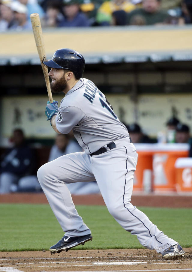 Seattle Mariners' Dustin Ackley drives in a run with a single against the Oakland Athletics during the first inning of a baseball game on Tuesday, May 6, 2014, in Oakland, Calif. (AP Photo/Marcio Jose Sanchez)