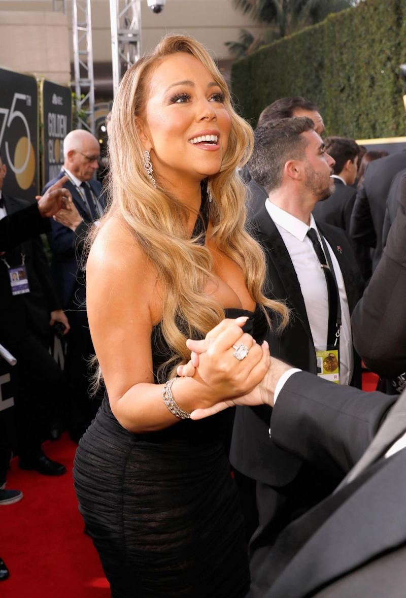 Mariah was also wearing the $13 million engagement ring her ex-fiancé James Packer gave her on her right hand. Source: Getty