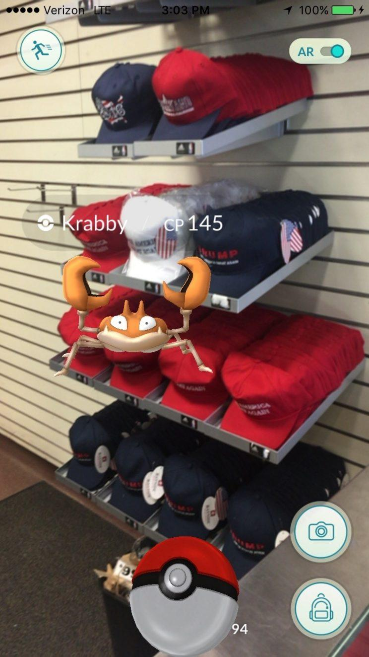 Capturing a Krabby Pokémon on top of a pile of Donald Trump