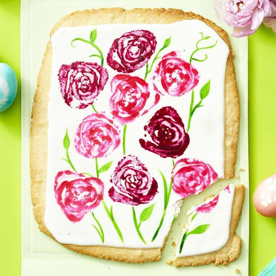 """<p>The best homemade gifts are edible, and this massive sugar cookie is no exception.</p><p><a href=""""https://www.womansday.com/food-recipes/a35681467/giant-sugar-cookie-bouquet-recipe/"""" rel=""""nofollow noopener"""" target=""""_blank"""" data-ylk=""""slk:Get the Giant Sugar Cookie Bouquet recipe."""" class=""""link rapid-noclick-resp""""><strong><em>Get the Giant Sugar Cookie Bouquet recipe.</em></strong></a></p>"""