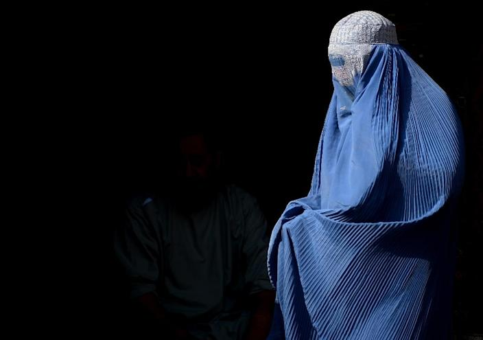 """A woman is seen in Afghanistan in July 2016 wearing a burqa, the garment that Swiss voters will be called to decide on in the initiative """"Yes to a ban on face coverings"""", presented by a committee run by a member of the rightwing Swiss People's Party (AFP Photo/AREF KARIMI)"""