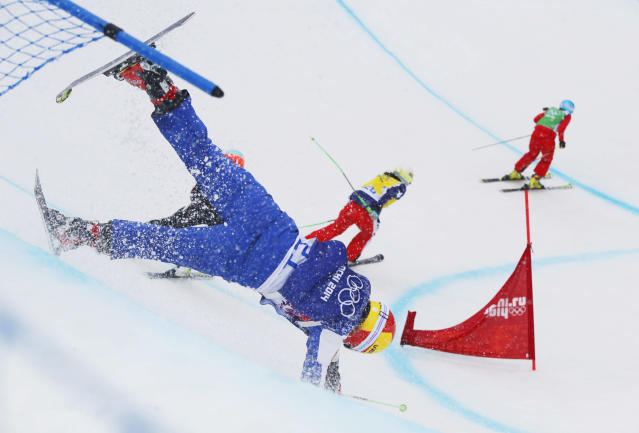Russia's Anastasia Chirtcova crashes during a takes a women's ski cross heat at the Rosa Khutor Extreme Park, at the 2014 Winter Olympics, Friday, Feb. 21, 2014, in Krasnaya Polyana, Russia. Ahead of her are Chile's Stephanie Joffroy, center, and Switzerland's Katrin Mueller, right. (AP Photo/Sergei Grits)