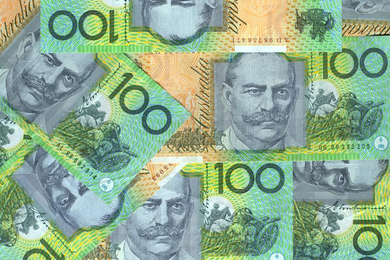 Pictured: Australian $100 notes. Image: Getty