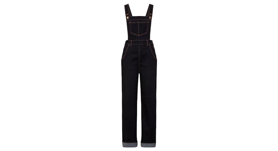 """<p>We love these dark denim dungarees by plus size brand Hell Bunny.<br><a rel=""""nofollow noopener"""" href=""""https://hellbunny.com/5474-ellie-may-denim-dungaree.html"""" target=""""_blank"""" data-ylk=""""slk:Buy here."""" class=""""link rapid-noclick-resp"""">Buy here.</a> </p>"""