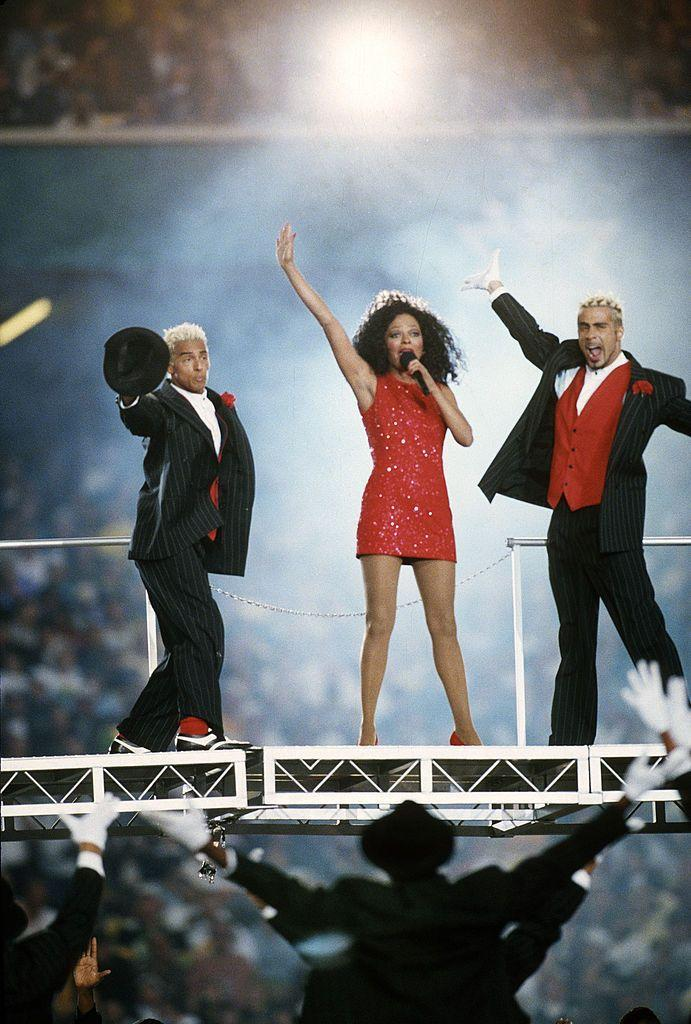 """<p>Ross wore not one, not two, but three ensembles for her halftime show, starting off with this red sequinned mini dress.</p><p><a class=""""link rapid-noclick-resp"""" href=""""https://www.youtube.com/watch?v=RCEY7kXDvCQ&ab_channel=NandyRoss"""" rel=""""nofollow noopener"""" target=""""_blank"""" data-ylk=""""slk:WATCH NOW"""">WATCH NOW</a></p>"""