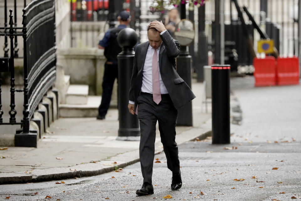 FILE - In this Wednesday, Sept. 23, 2020 file photo British Health Secretary Matt Hancock walks through Downing Street on his way into number 10, in London. More than 100,000 people have died in the United Kingdom after contracting the coronavirus. That's according to government figures released Tuesday Jan. 26, 2021. Britain is the fifth country in the world to pass that mark, after the United States, Brazil, India and Mexico, and by far the smallest. The U.S. has recorded more than 400,000 COVID-19 deaths, the world's highest total, but its population of about 330 million is about five times Britain's. (AP Photo/Matt Dunham, File)