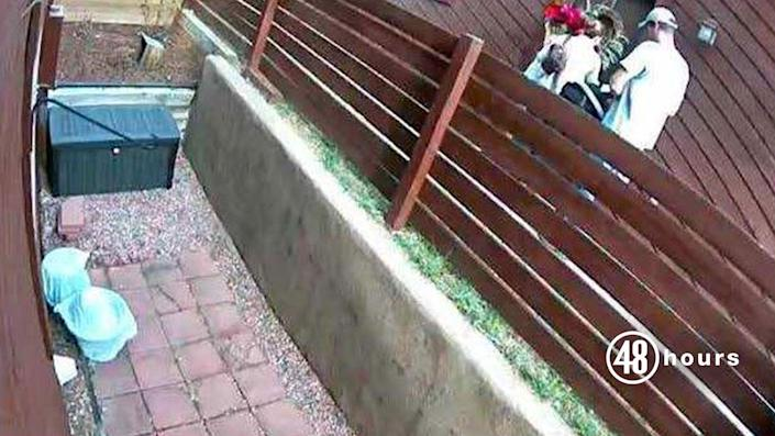 On November 22, 2018 at 1:23 p.m., a neighbor's surveillance camera captures Kelsey Berreth, Patrick Frazee and their daughter Kaylee entering Berreth's home. Berreth is carrying a poinsettia plant she had just purchased at Safeway. This image was captured shortly before her murder. / Credit: Teller County DA's Office