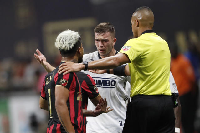 An official steps between Atlanta United forward Josef Martinez (7) and Philadelphia Union defender Kai Wagner (27) as they exchange words during the first half of an MLS soccer Eastern Conference semifinal Thursday, Oct. 24, 2019, in Atlanta. (AP Photo/John Bazemore)