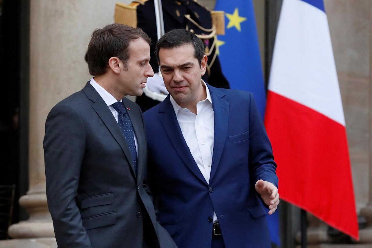 French President Emmanuel Macron (L) accomapanies Greek Prime Minister Alexis Tsipras after a meeting at the Elysee Palace in Paris, France, November 24, 2017. REUTERS/Gonzalo Fuentes