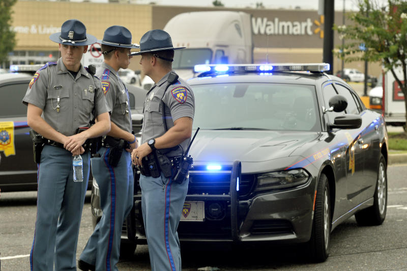 Officers stand at the scene of a shooting inside a Walmart store Tuesday, July 30, 2019 in Southaven, Miss. (AP Photo/Brandon Dill)