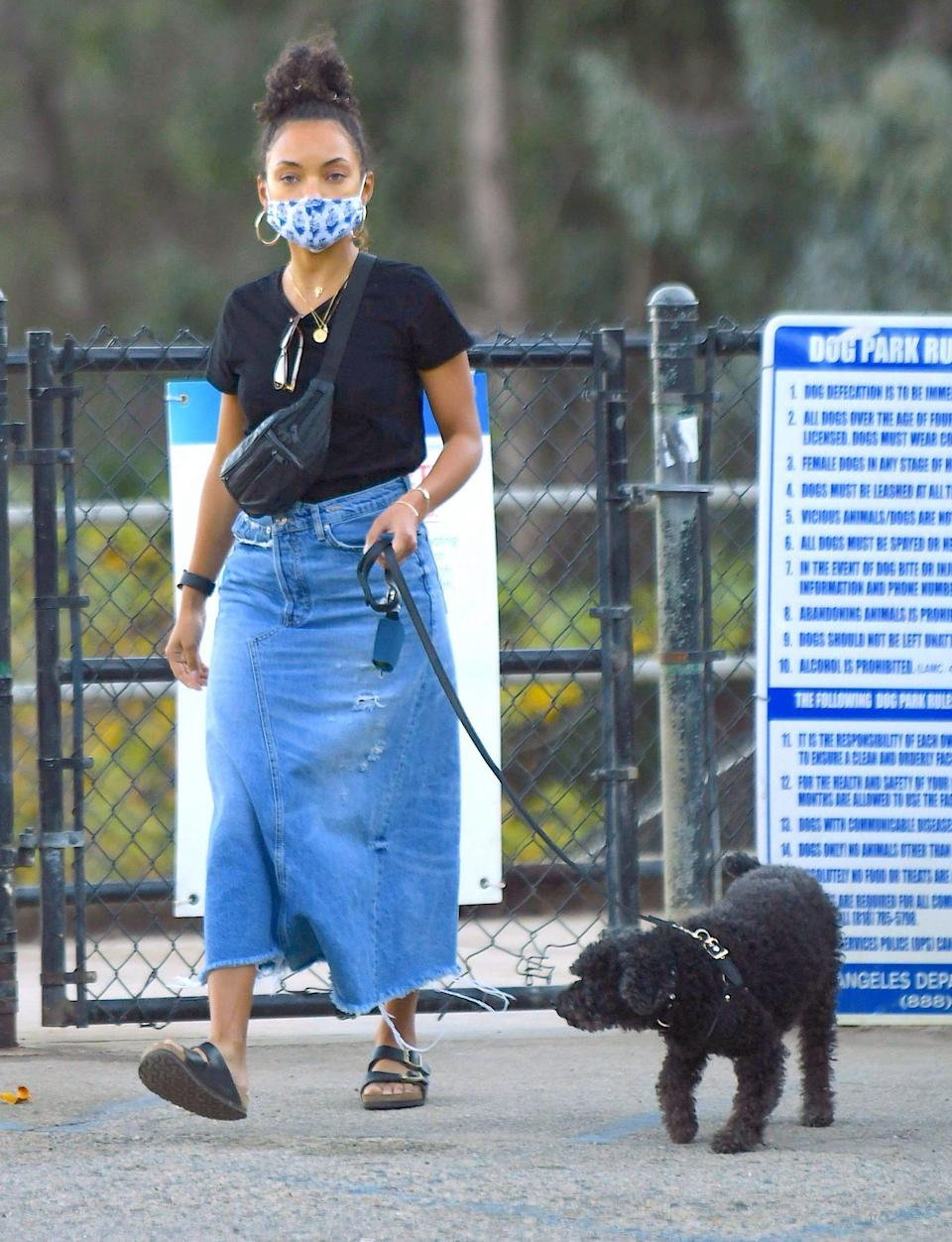 <p>Logan Browning and her pooch make a masked visit to a dog park in Los Angeles on Tuesday.</p>