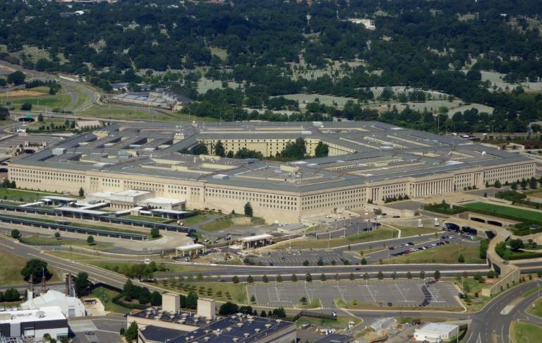 The normally busy halls of the Pentagon have thinned, with thousands told to work from home (AFP Photo/SAUL LOEB)