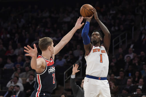 New York Knicks forward Bobby Portis (1) shoots the ball as Washington Wizards forward Moritz Wagner (21) defends during the second half of an NBA basketball game, Wednesday, Feb. 12, 2020, in New York. The Wizards won 114-96. (AP Photo/Sarah Stier)