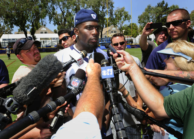 Dallas Cowboys wide receiver Dez Bryant talks to members of the media after morning practice during NFL football training camp, Friday, July 25, 2014, in Oxnard, Calif. (AP Photo/Gus Ruelas)