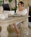 <p>For her 40th birthday, the Duchess of Sussex launched her 40x40 initiative aimed at helping women reenter the workforce. In the promotional video, Markle videochatted with Melissa McCarthy and wore an all-ivory ensemble with camel-colored suede pumps and layered necklaces. </p>