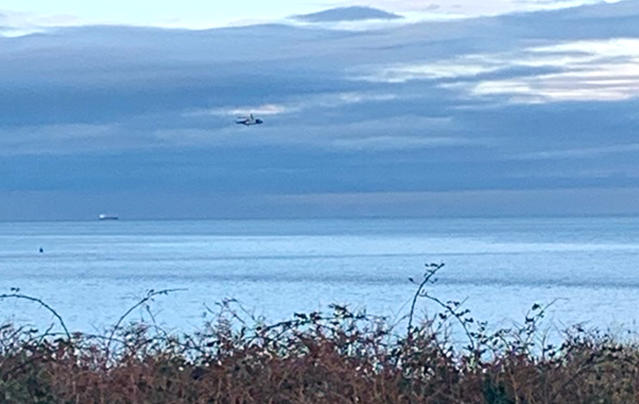 HM Coastguard said it was coordinating a search in the Puffin Island area near Anglesey after the light aircraft disappeared from radar at around midday on Monday. (PA)