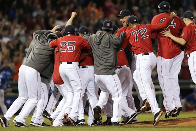 The Boston Red Sox celebrate after clinching the AL East with a 6-3 win over the Toronto Blue Jays in a baseball game at Fenway Park, Friday, Sept. 20, 2013, in Boston. (AP Photo/Charles Krupa)