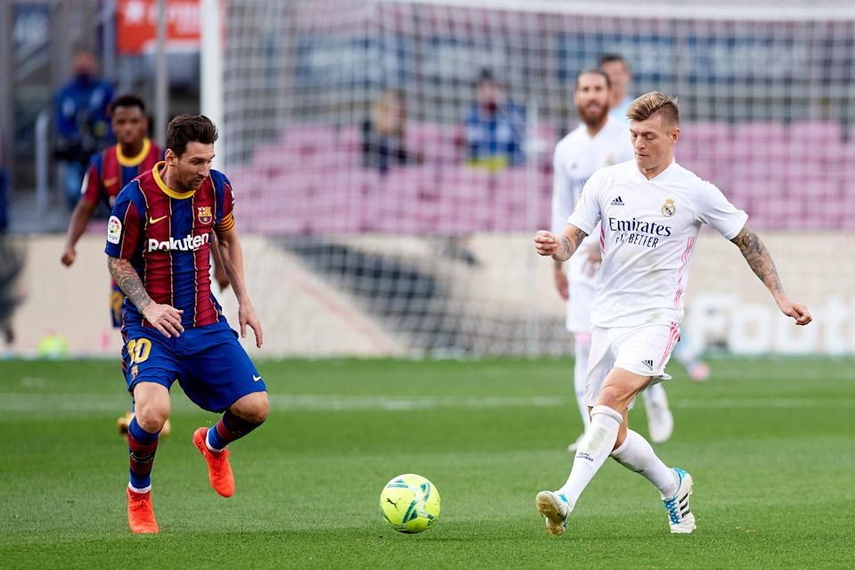 Lionel Messi of Barcelona competes for the ball with Toni Kroos of Real Madrid during their El Clasico clash on 24 October 2020.